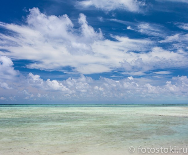 Beautiful Tropical white Sand Beach and crystal clear water. Sipadan Island, Borneo, Malaysia.