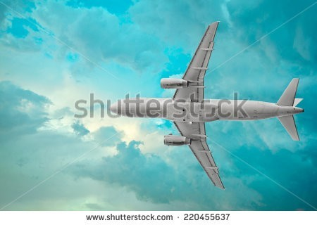 stock-photo-passenger-airplane-on-the-beautiful-cumulus-clouds-background-220455637