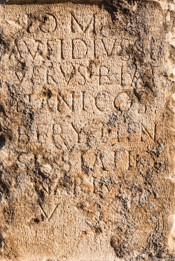 Pillar of stone with ancient Roman text in Byblos, Lebanon